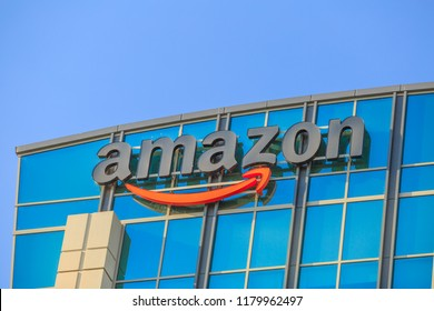 Sunnyvale, California, USA - August 13, 2018: closeup of Amazon Sign atop of glass building of Big Amazon campus in Silicon Valley. Amazon is leader in electronic commerce and cloud computing.