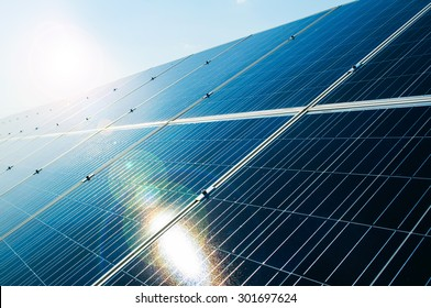 Sunray reflecting on solar power photovoltaic panel as green and renewable electric energy solution concept
