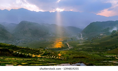 Sunray through clouds and mountains at rice fields in Sapa Vietnam
