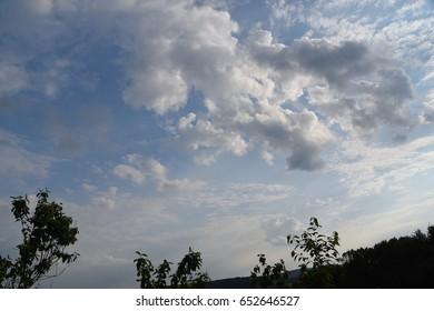 Sunrays shine through clouds
