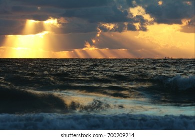 Sunrays at sunset at sea