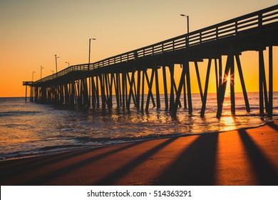 Sunrise at the 15th Street Pier in Virginia Beach, Virginia.