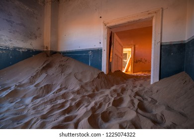 Sunrise in the abandoned houses in Kolmanskop ghost town, Namibia.