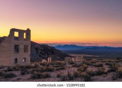 Sunrise above abandoned building in the town of Rhyolite, Nevada. This ghost town is located in Nye County among Bullfrog Hills near Death Valley.
