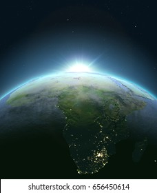 Sunrise above Africa. Concept of new beginning, hope, light. 3D illustration with detailed planet surface, atmosphere and city lights. Elements of this image furnished by NASA.