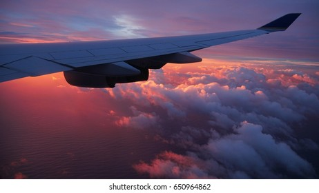 Sunrise above the airplane wing A beautiful sunrise above the clouds and airplane wing
