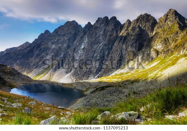 Sunrise above the alpine lake.. High Tatras (Satan Peak - Slovakia)
