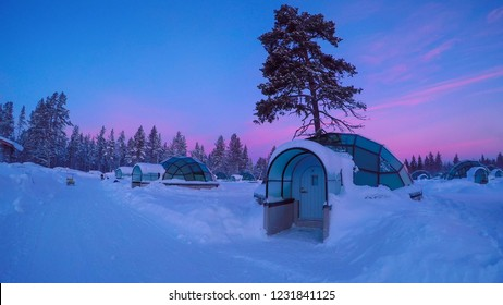 Sunrise above amazing glass igloo village at Kakslauttanen Arctic Resort Finland