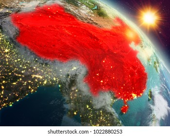 Sunrise above China highlighted in red on model of planet Earth in space. 3D illustration. Elements of this image furnished by NASA.