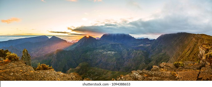 "Sunrise above the ""Cirque de Mafate"" at the island of ""La Reunion"" seen from the peak ""Maido"" (panorama)"