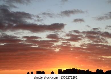 Sunrise above a city