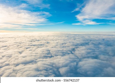 Sunrise above clouds from airplane window