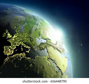 Sunrise above EMEA region. Concept of new beginning, hope, light. 3D illustration with detailed planet surface, atmosphere and city lights. Elements of this image furnished by NASA.