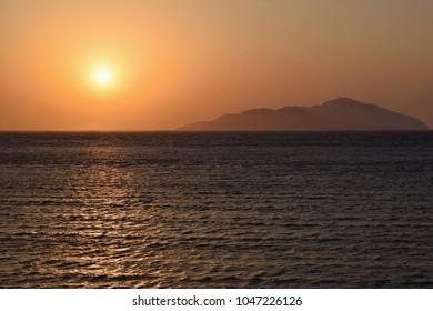 Sunrise above lonely island