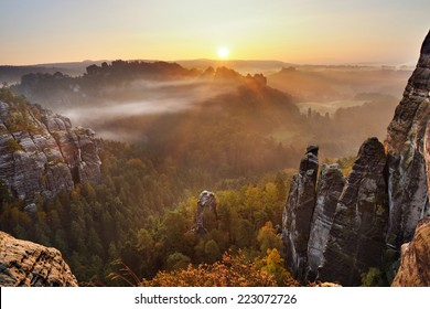 Sunrise above the misty and rocky valley in national park Saxony Switzerland