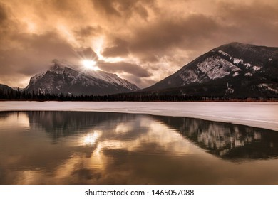 Sunrise above Mount Rundle reflecting off Vermilion Lakes during Winter in the Canadian Rockies of Banff National Park.