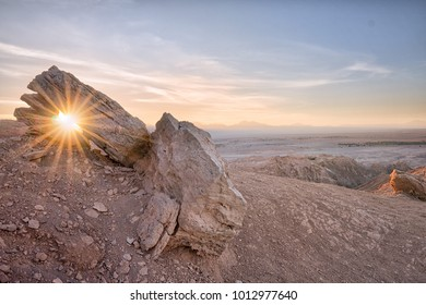 Sunrise above San Pedro de Atacama through the Stone arch next to the valle de la Luna