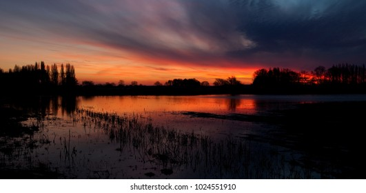 Sunrise across flooded field near Oundle in Northamptonshire