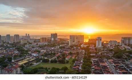 Sunrise aerial landscape view of Georgetown city in Penang, Malaysia.