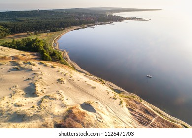 Sunrise aerial view with  bay, dunes and city of Nida in Curonian spit, Lithuania