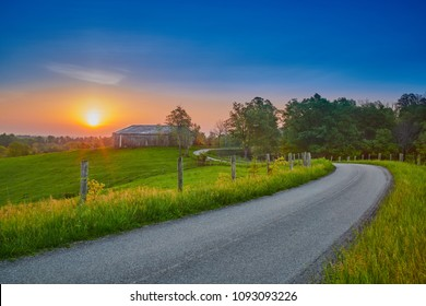 Sunrise Along  a Counrty Road with Barn