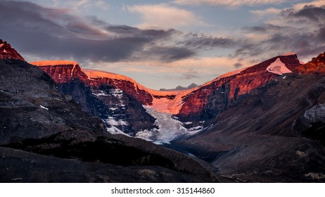 Sunrise Alpenglow lights up Dome Glacier in Jasper National Park, Canada.