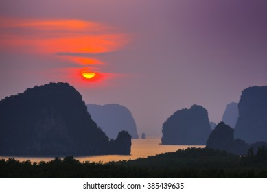 Sunrise among the islands of the Andaman Sea. This photo was taken from Samed Nang She view point, Phangnga, Thailand.