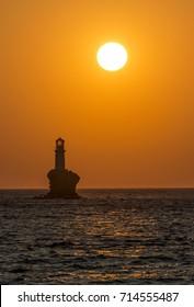 Sunrise in Andros island/Tourlitis lighthouse