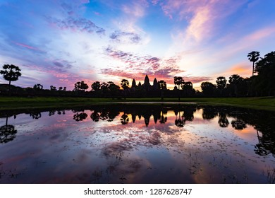 Sunrise at Angkor Wat. the temple faces west and so the sun rises dramatically from behind its iconic spires. The quintessential shot of Angkor Wat at sunrise is taken from behind the reflection pools