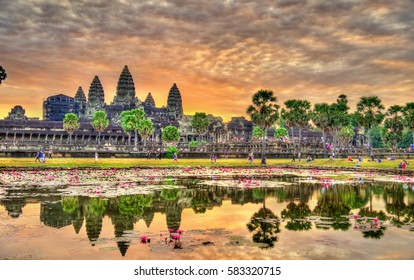Sunrise at Angkor Wat, a UNESCO world heritage site in Cambodia. Built in the 12th century, it is the largest religious monument in the world.