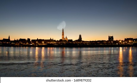 Sunrise in Antwerp, the city of diamonds. A beautiful composition with moon and birds over Our Lady Cathedral.