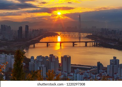 Sunrise and Autumn season of Seoul downtown, Hangang river and Lotte tower in Seoul, South Korea.Viewpoint from Maebongsan mountain.