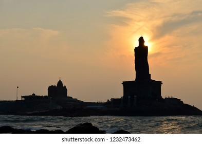 Sunrise from back of the head of statue of Thiruvalluvar as seen from Kanyakumari temple at the southern tip of mainland India at Kanyakumari, India.