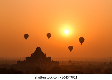 Sunrise in Bagan - temple with hot air ballon