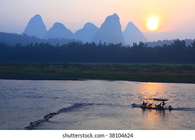 Sunrise with bamboo boat at Yangshuo on the Li River, China