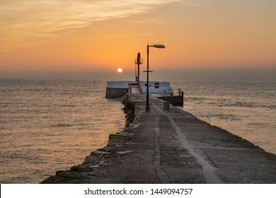 Sunrise at the banjo pier Looe Cornwall Uk on the Cornish coast