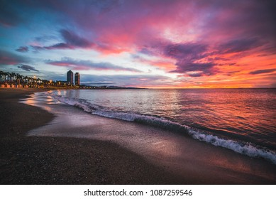 Sunrise in Barcelona close to Barceloneta Beach, beautiful viewpoint of the sea and the city, Spain