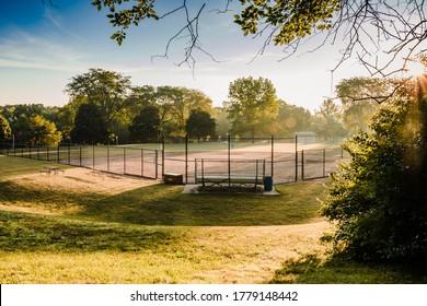 sunrise at a baseball field in a municipal park