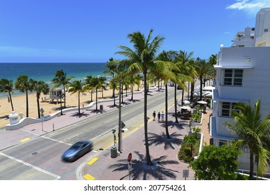 Sunrise Beach in Ft.Lauderdale with palm trees and beach entry feature.