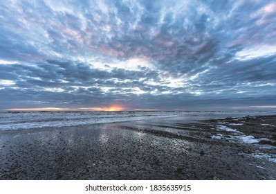 Sunrise at the beach of Island Norderney - Shutterstock ID 1835635915