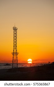 The sunrise at beach on the East Sea with telecommunication tower