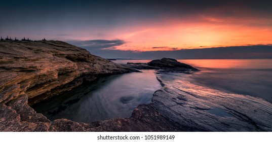 Sunrise at beautiful Black Sea coast. Romantic sunrise view from Ravda, Bulgaria coast.