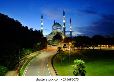 Sunrise at The beautiful Sultan Salahuddin Abdul Aziz Shah Mosque (also known as the Blue Mosque) located at Shah Alam, Selangor, Malaysia.