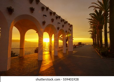 Sunrise and a beautiful white building at Balcony of Europe in Nerja Spain