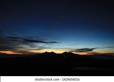 Sunrise behind the Halimun Salak Mountain range. Sunrise scene with Silhouette mountain. Bogor-Indonesia