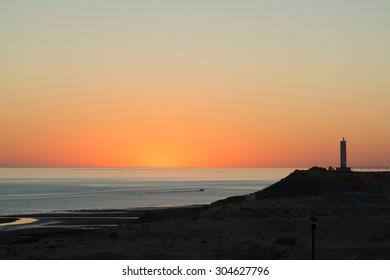 Sunrise behind the lighthouse