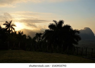 Sunrise behind the palmtrees in the mountains of Los Acuaticos, near the Vinales Valley in Cuba
