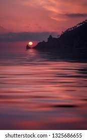 Sunrise behind rocks and cap