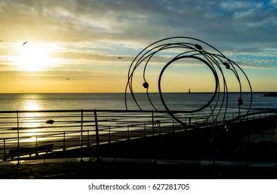 Sunrise behind Roker Lighthouse O in Sunderland England horizontal photography