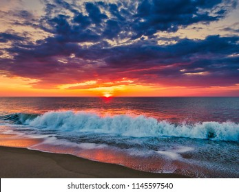 Sunrise from the Bethany Beach, Delaware, with dramatic skycap and surf.
